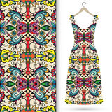 Seamless floral geometric pattern, women's dress. On a hanger. Tribal ethnic ornament fabric texture Stock Photography