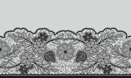 Seamless floral lace ribbon on gray. Royalty Free Stock Photography