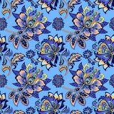 Seamless floral ornament on a blue background Stock Image