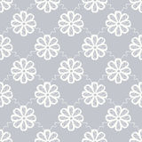 Seamless floral pattern. Elegant seamless symmetric floral pattern with white stylistic flowers on grey background Royalty Free Stock Photos