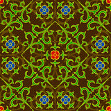 Seamless floral pattern. Ornament consists of red and blue flowers and green leaves on the brown background Stock Image