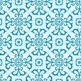 Seamless floral pattern. Ornament of blue colour consists of abstract flowers and leaves and  white squares in the background Stock Images
