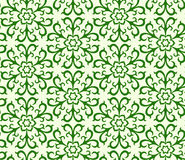 Seamless floral pattern. Ornament of green colour consists of abstract flowers and leaves Stock Photography