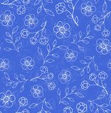 Seamless floral pattern. Seamless pattern with simple stylized flowers and leaves on a blue background Royalty Free Stock Image