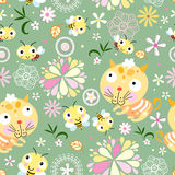 Seamless floral pattern with bees and kittens. Seamless multi-colored floral pattern with bees and kittens on a green background Stock Photos