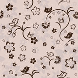 Seamless floral pattern with birds on beige background, vector Royalty Free Stock Photography