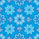 Seamless floral pattern on a blue background Stock Photos