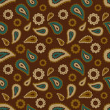 Seamless floral pattern with blue, beige and brown plants, flowers and leaves on brown background. Ethnic oriental print with cucu Royalty Free Stock Image