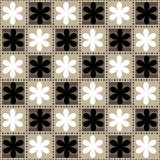 Seamless floral pattern in a checkerboard pattern. Alternate black and white flowers. Black striped flowers on the square Royalty Free Stock Photography