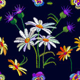 Seamless floral pattern with embroidered pansies and chamomiles. Stock Images