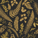 Seamless floral pattern. Gold. Seamless floral pattern in vintage style. Golden leaves and grass on a black background. Vector design elements Stock Images