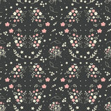 Seamless floral pattern hand drawn small white silhouette flowers in bouquet twigs berries on dark grey background, fabric, scrapb Royalty Free Stock Images