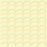 Seamless floral pattern. Orange and green pastel colors on a light yellow background, spring, summer Stock Images
