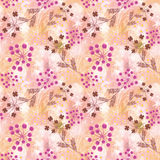 Seamless floral pattern,orange -pink flowers on a beige watercolor background. Royalty Free Stock Photo