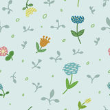 Seamless floral pattern with pastel flowers and leaves on grey background. Stock Images