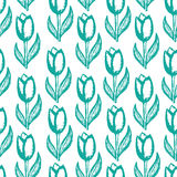 Seamless, floral pattern with a print of tulips Royalty Free Stock Images