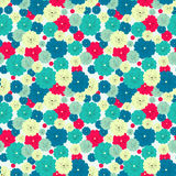 Seamless floral pattern with red, blue, green, light yellow flowers placed randomly. Royalty Free Stock Images