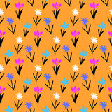 Seamless floral pattern with small flowers. Ditsy spring floral pattern with small hand drawn flowers on orange background. Seamless vector vintage texture Stock Photo