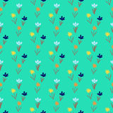 Seamless floral pattern with small flowers. Ditsy spring floral pattern with small hand drawn flowers on tropical green background. Seamless vector vintage Royalty Free Stock Photo