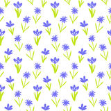 Seamless floral pattern with small flowers. Ditsy spring floral pattern with small hand drawn violet flowers on white background. Seamless vector vintage texture Stock Photography