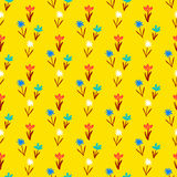 Seamless floral pattern with small flowers. Ditsy spring floral pattern with small hand drawn flowers on yellow background. Seamless vector vintage texture Royalty Free Stock Image