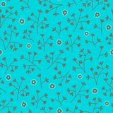 Seamless floral pattern with small flowers. Floral pattern. Endless bright blue background. Stock Image
