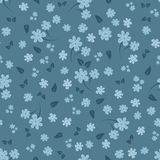 Seamless floral pattern. Small flowers and leaves. Blue shades. Template for the design of textiles for women`s clothing, wrapping paper, curtains, bed linen Royalty Free Stock Image