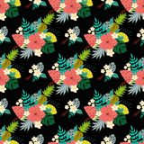 Seamless floral pattern with tropical flowers exotic fresh fruits on black. Vector illustration. Seamless floral pattern with tropical flowers on black. Vector vector illustration