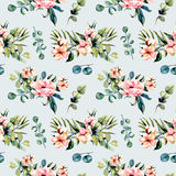 Seamless floral pattern with watercolor pink flowers and eucalyptus branches bouquets. Hand drawn on a blue background Royalty Free Stock Photo