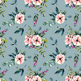 Seamless floral pattern with watercolor pink flowers and eucalyptus branches bouquets. Hand drawn on a dark blue background Stock Image