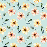 Seamless floral pattern with watercolor pink flowers, green leaves and branches. Hand drawn isolated on a blue background Royalty Free Stock Images