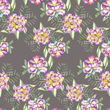 Seamless floral pattern with the watercolor violet and yellow exotic flowers and green leaves Stock Photography