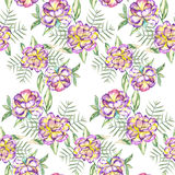 Seamless floral pattern with the watercolor violet and yellow exotic flowers and green leaves Royalty Free Stock Photos