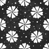 Seamless floral pattern with white flowers and dots on black background Stock Image