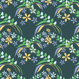 Seamless floral vector pattern. Decorative background with flowers and keaves on the blue backdrop Stock Images