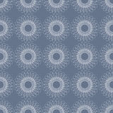 Seamless floral vector pattern; symmetrical abstract background with flowers, on the blue backdrop.  Royalty Free Stock Photos