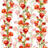 Seamless floral wallpaper with red freesia flower on green buds background Stock Photo