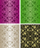Seamless floral wallpapers - set of four colors. Royalty Free Stock Images