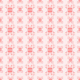 Seamless Flourish pattern in red on pink Royalty Free Stock Photos