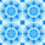 Seamless fractal based tile with a flower or mandala design. In shades of icy blue. For print on textiles, sheets, tablecloths, wrapping paper, wall/floor tiles Stock Photo