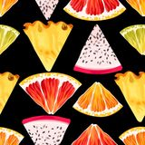Seamless fruit pattern. Seamless tropic fruits slices on black background Royalty Free Stock Photography