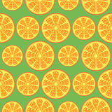 Seamless fruits vector pattern, bright close-up background with oranges over green backdrop Royalty Free Stock Photos