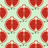 Seamless fruits vector pattern, bright color background with pomegranates and branches with leaves, over light backdrop Royalty Free Stock Photography