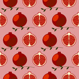 Seamless fruits vector pattern, bright color symmetrical background with pomegranates, whole and half, over red backdrop Stock Images