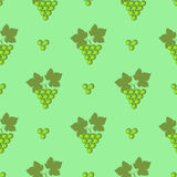 Seamless fruits vector pattern, bright symmetrical background with grapes and leaves, over green backdrop Royalty Free Stock Photos