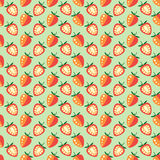 Seamless fruits vector pattern, symmetrical background with strawberries, whole and half, on the green backdrop.  Stock Photo