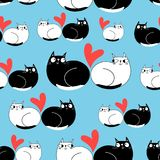 Seamless funny pattern of enamored cats. On a blue background Royalty Free Stock Photos