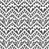Seamless geometric background. Grey zigzags on a white background. Handmade. Ethnic ornament, tribal motifs Stock Photos