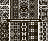10 seamless geometric black and white patterns. Set of 10 different seamless abstract geometric black and white patterns. Vector illustration for various Stock Illustration