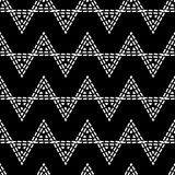 Seamless geometric pattern. Black and white texture. Drawn triangles. Drops texture. Brushwork. Scribble texture. Textile rapport Stock Images